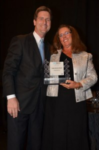 Greg Stanton receives the 2011 Public Service Award from Joan Koerber-Walker on behalf of AZBio