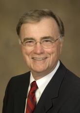 Dr. Raymond L. Woosley