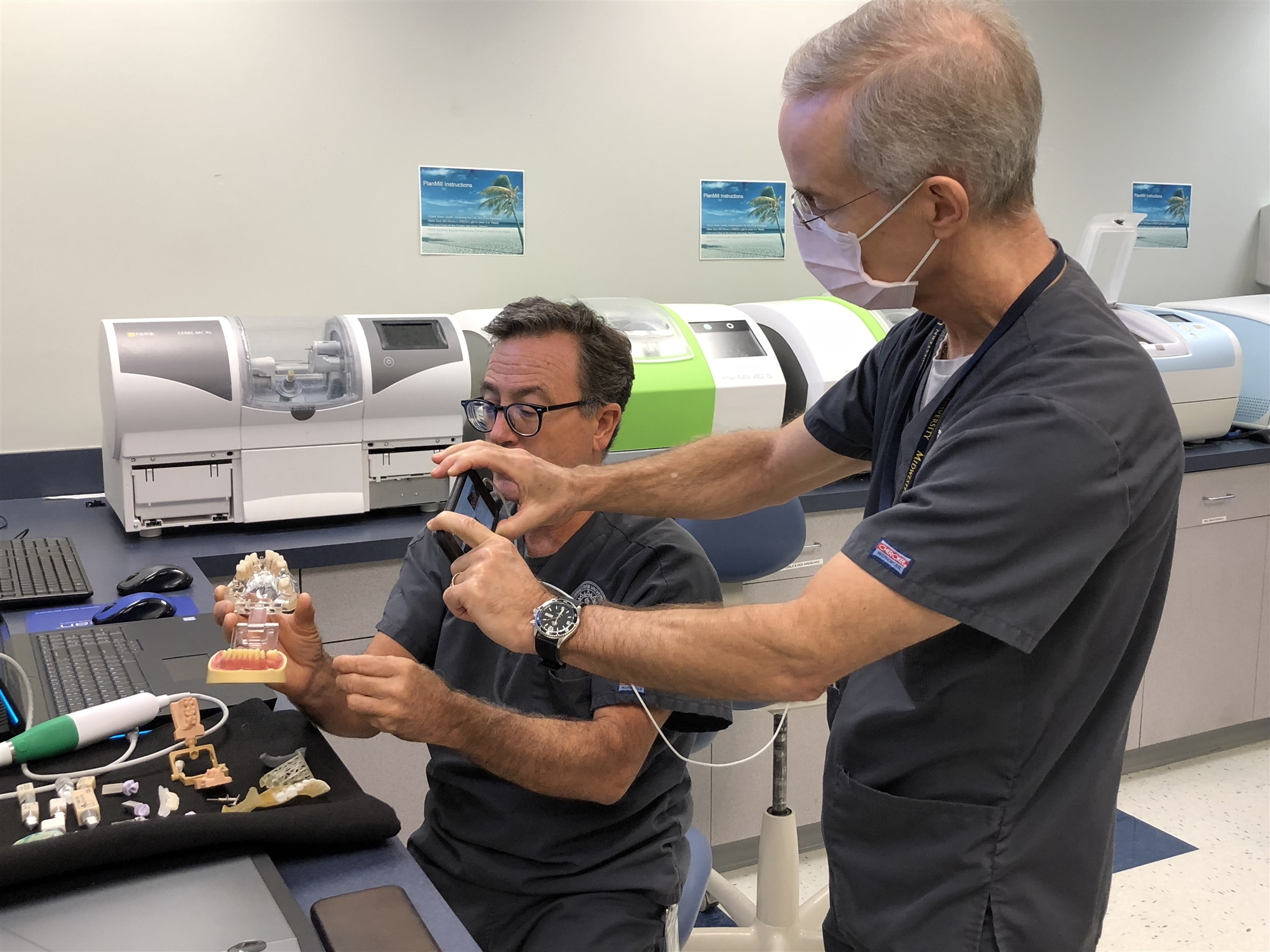 Thomas McDaniel, D.M.D., Professor, takes video of Robert Kramer, D.M.D., Director of PreClinical Faculty, as they present an online workshop at the 2020 Health Careers Institute for High School Students. (Photo courtesy of Midwestern University)