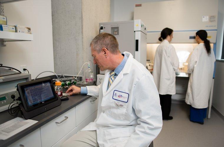 Frederic Zenhausern, PhD, working in lab