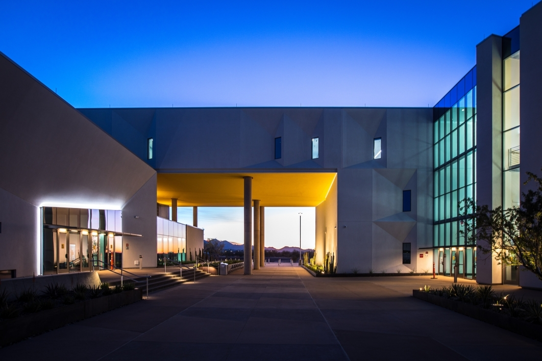 The two halves of the 150,000-square-foot Health Futures Center — which will house researchers from Mayo Clinic and several ASU schools and colleges — are connected by a courtyard on the ground level and a bridge above.